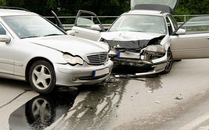 Image of two cars collided on the highway.