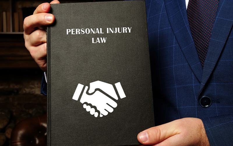 Lawyer holding book titled